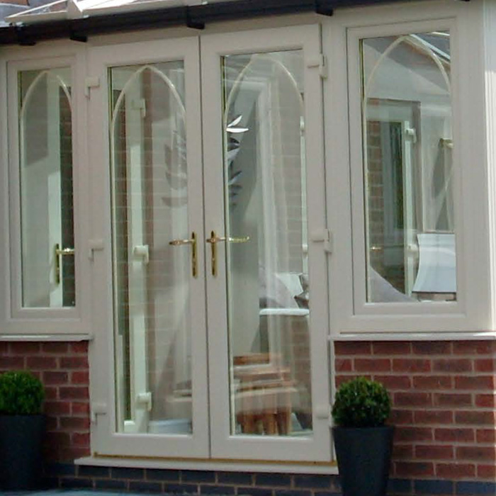 Upvc french doors from hussey and briggs for Wood effect upvc french doors