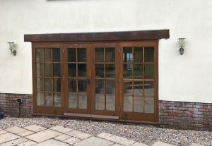 old rotten timber french doors in Dorset